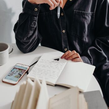 man writing in his happiness journal